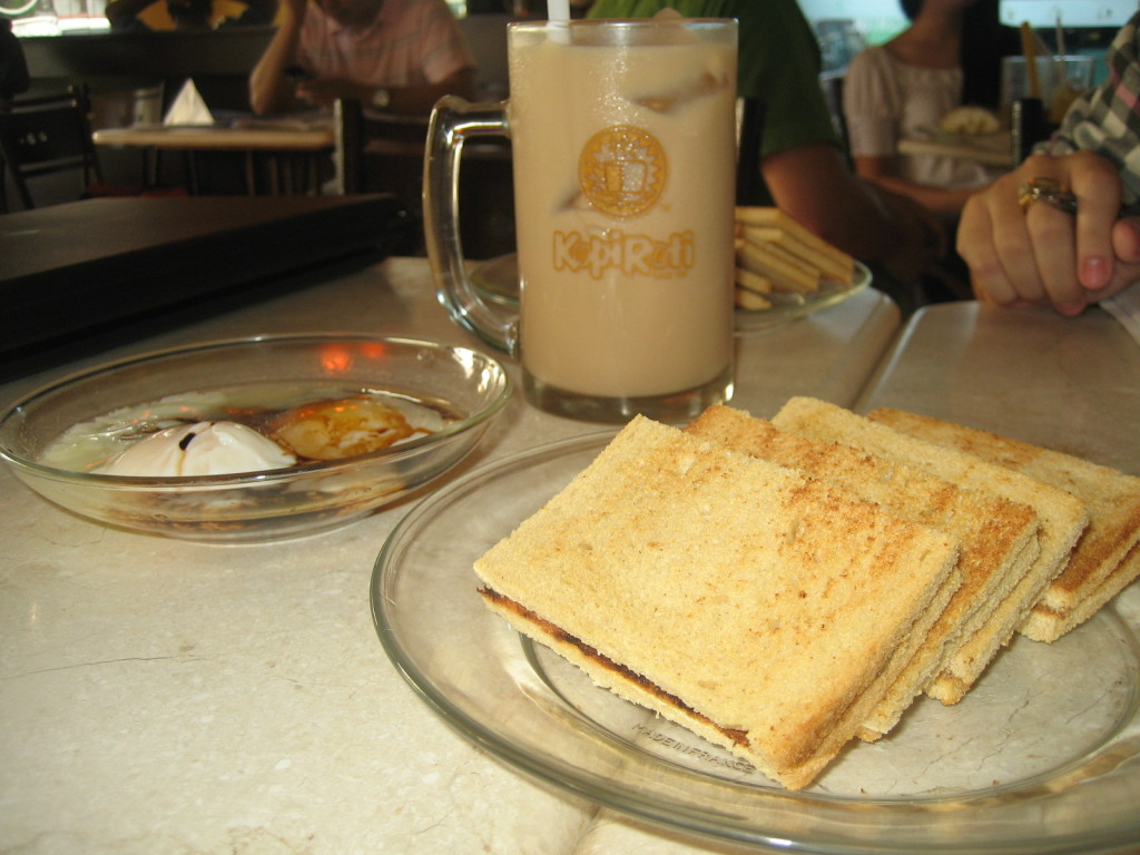 Iced tea with milk, soft boiled eggs and kaya toast